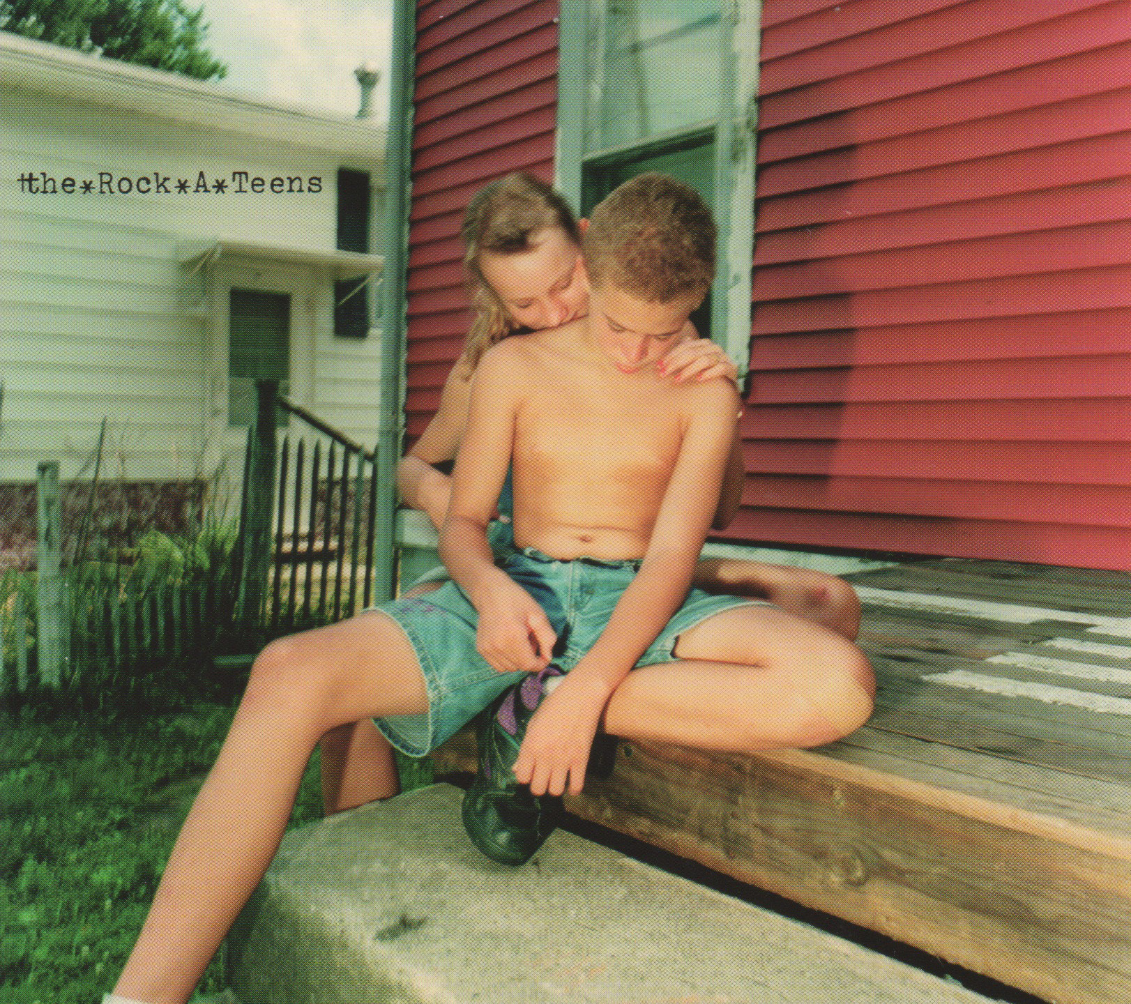 """Front cover of The Rock*A*Teens self-titled debut (Daemon Records, 1996)  Photo: """"Josh and His Girlfriend"""""""