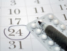Birth control pills and pen closeup .jpg