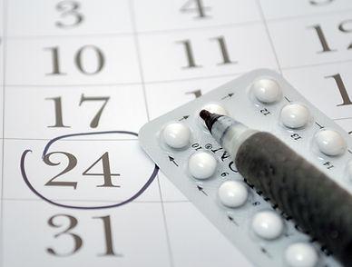 Birth control pills and pen closeup .jpg