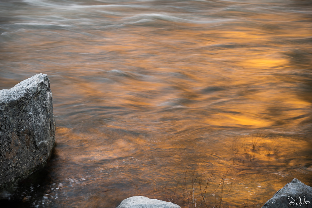 Sunset illuminates the merced river in a long exposure