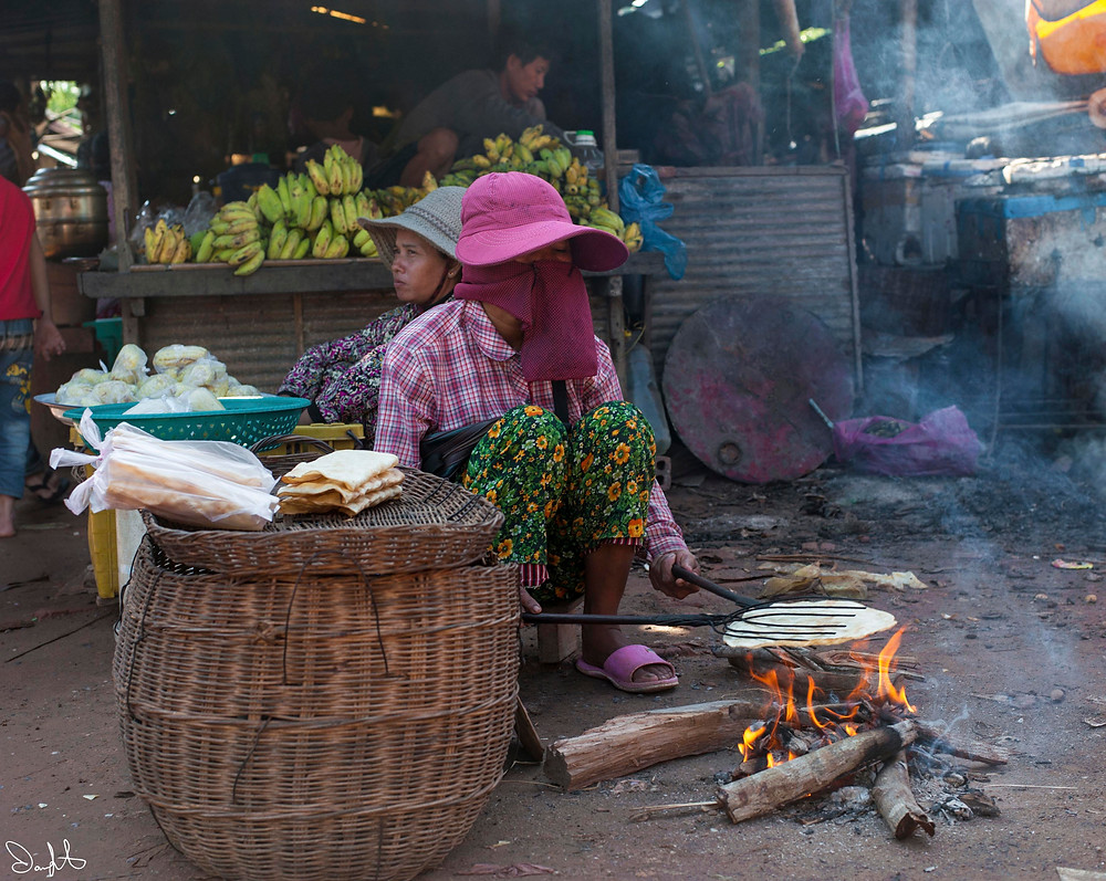 Cooking at the market, Siem Reap, Cambodia