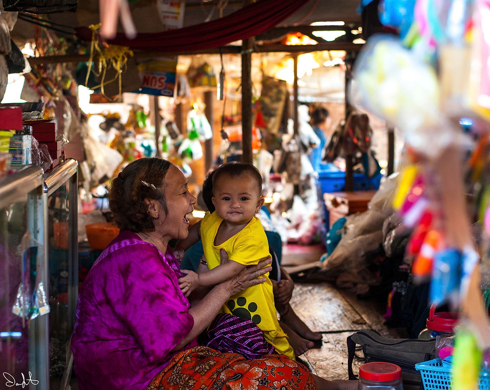 Woman and baby at market, Siem Reap, Cambodia