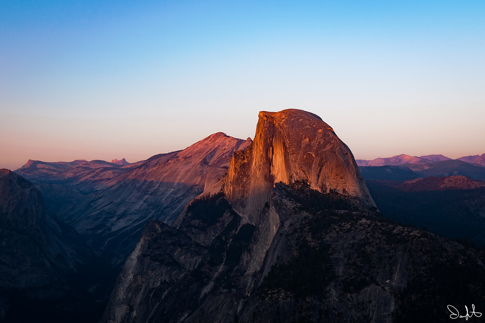 The sunset illuminates Half Dome, taken from Glacier Point