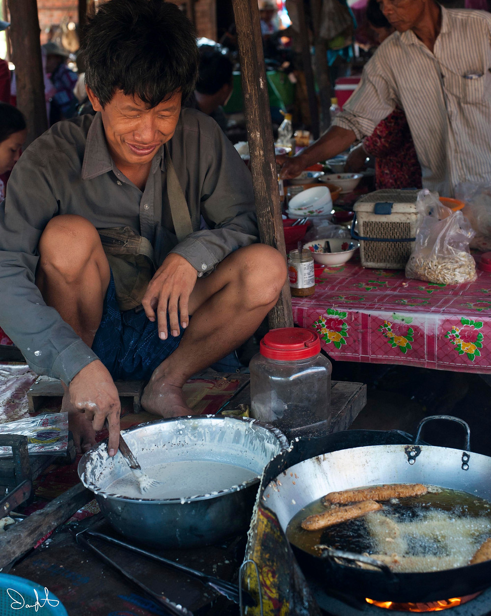 Man frying up breakfast at market, Siem Reap, Cambodia