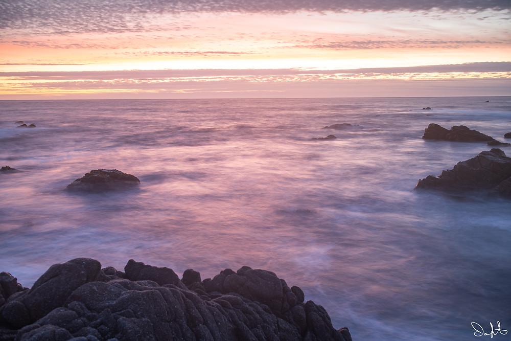 pink blue sunset over ocean