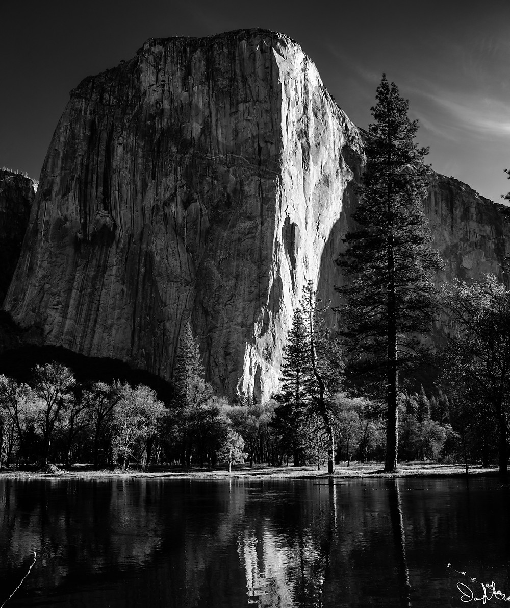 El Capitan is reflected in the flood-swollen water of the Merced River in spring