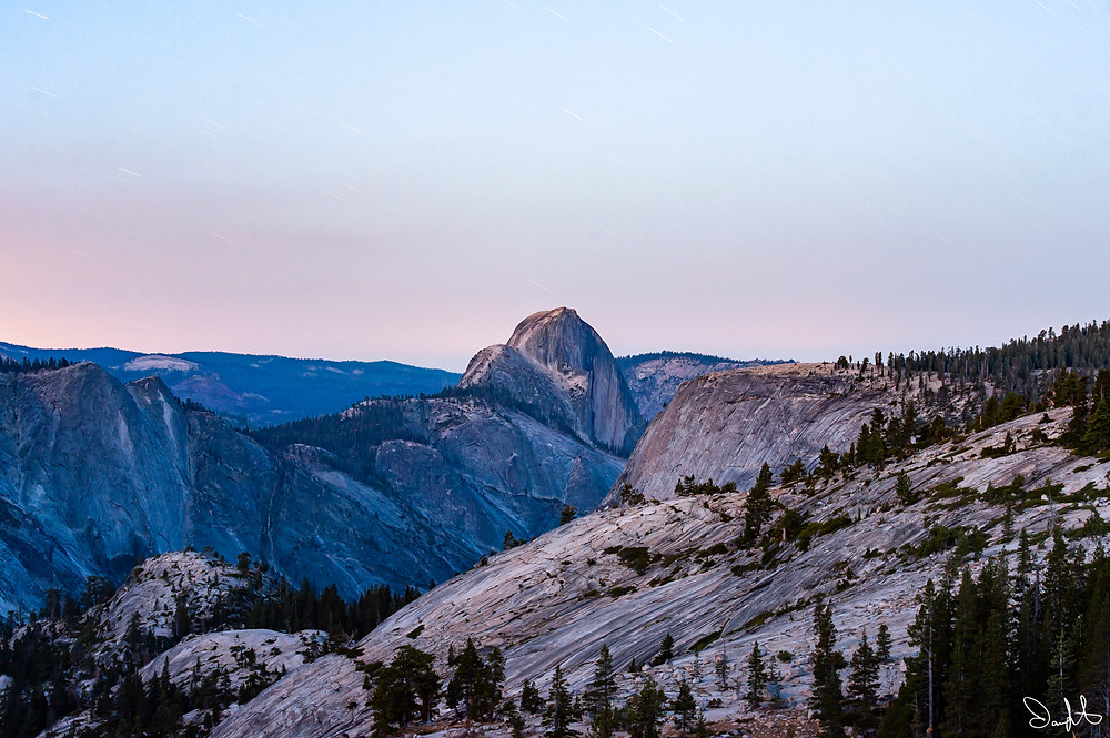 Sunrise behind Half Dome as the last stars fade into the dawn. Taken from Olmstead Point