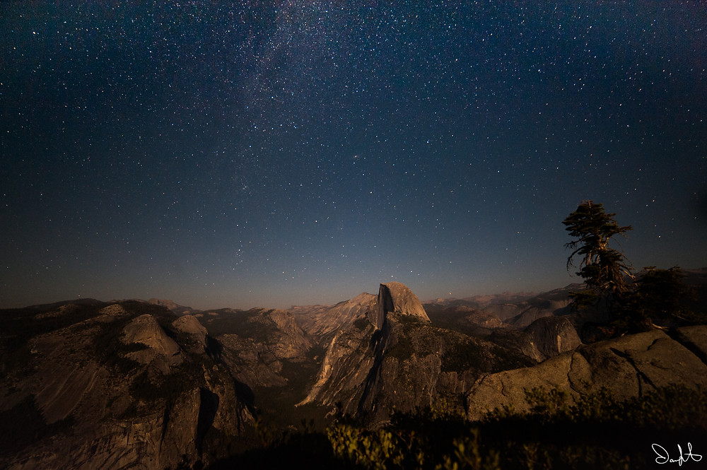Stars light up the sky behind Half Dome. Taken from Glacier Point