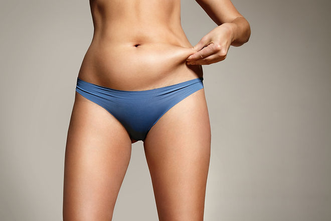 woman pinched her fat on body.jpg