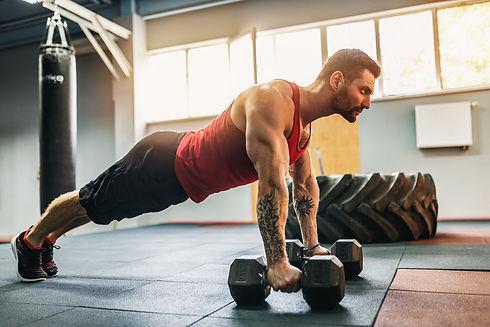 Muscular bearded man doing push-up exerc