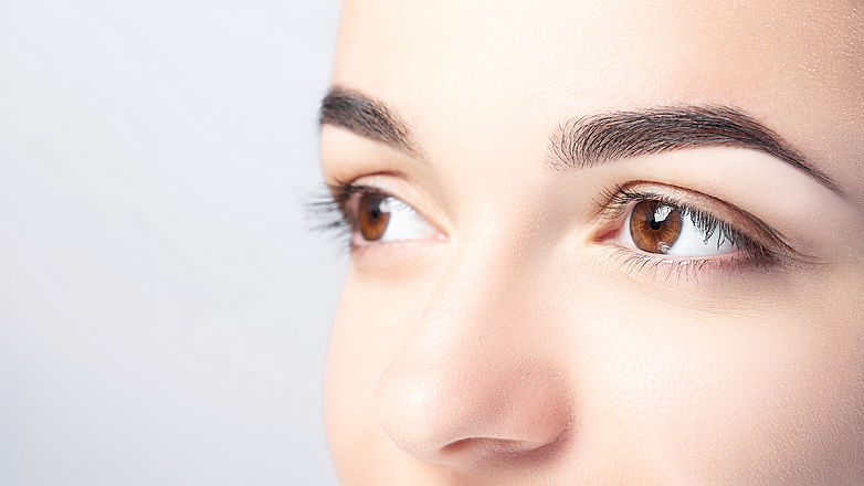 Woman with beautiful eyebrows close-up o