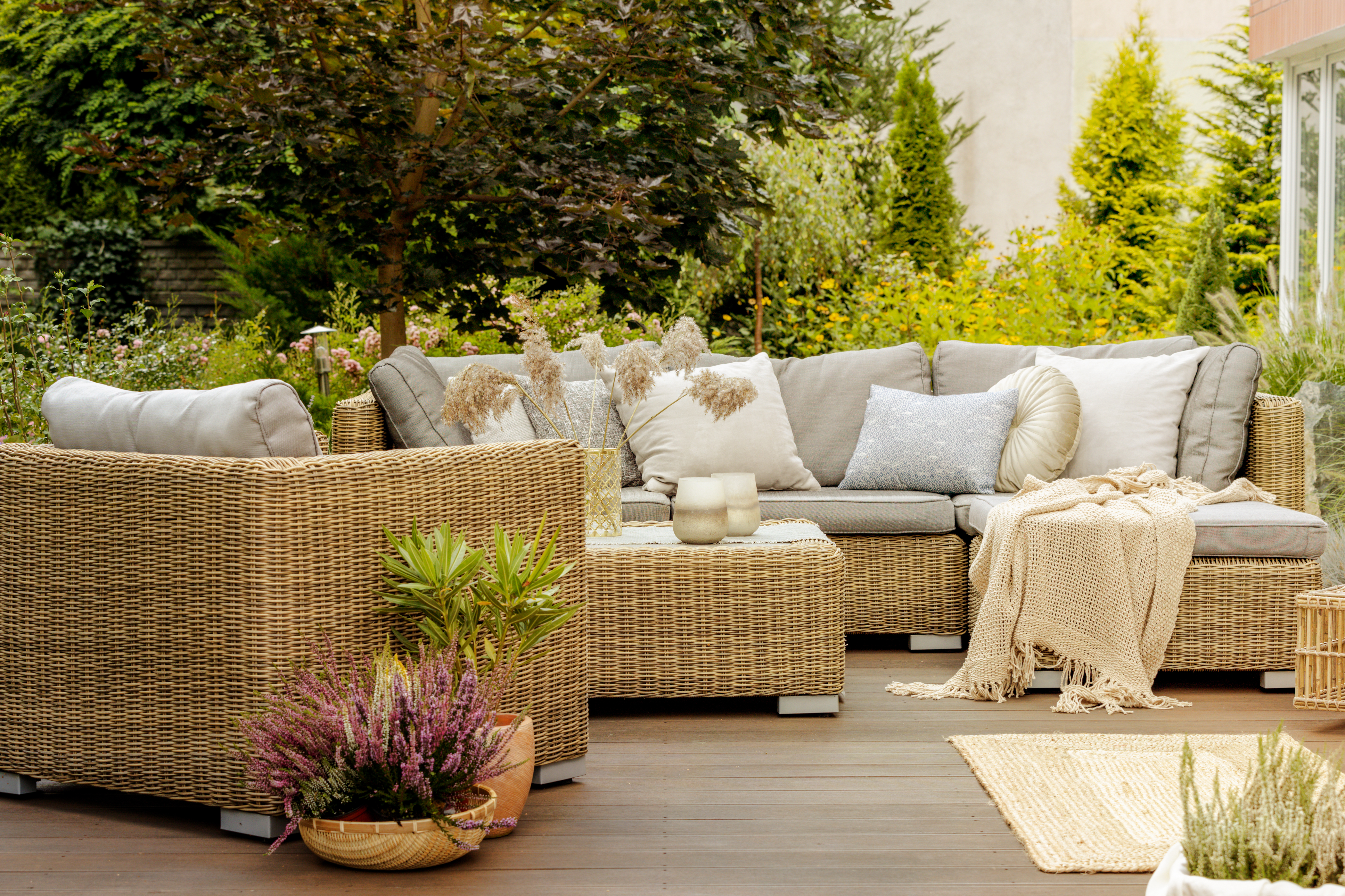 Wicker furniture on a wooden terrace of