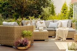 Wicker furniture on a wooden terrace of