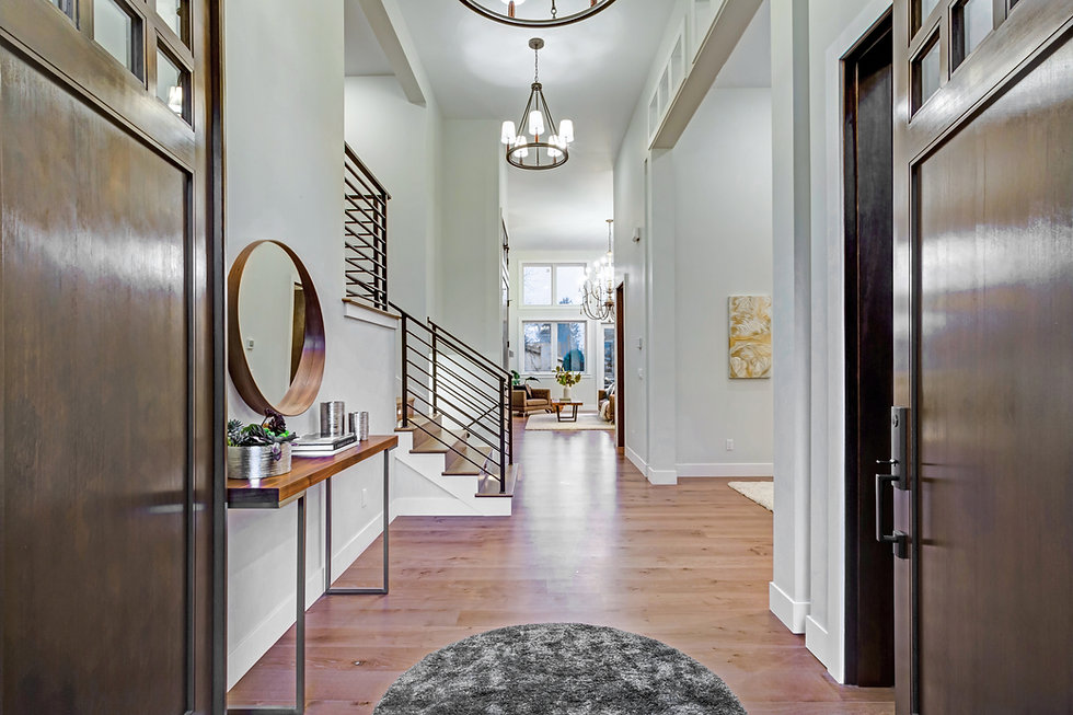 Chic entrance foyer with high ceiling an