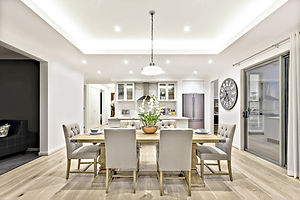 Modern dining room with hanging lamps on