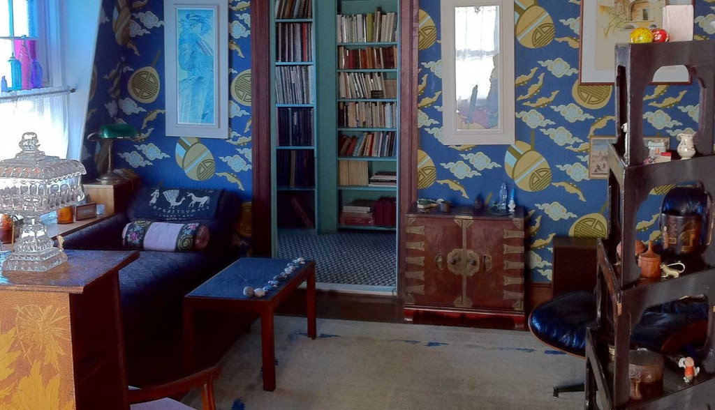 Merrill's living room featuring the commissioned bat wallpaper referred to in one of his poems.