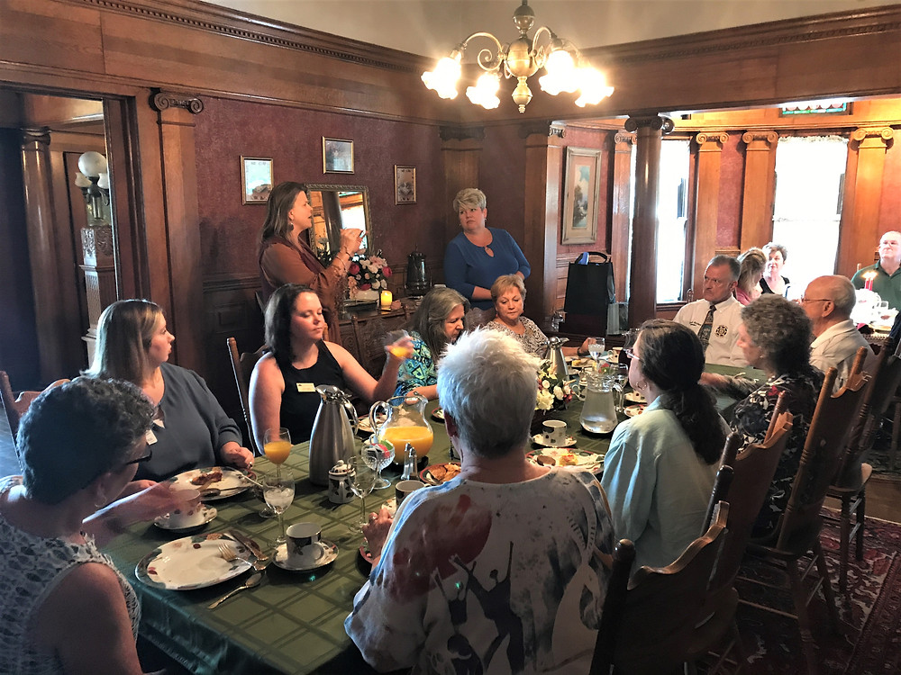 Dining room table with guest from the Toccoa Chamber of Commerce