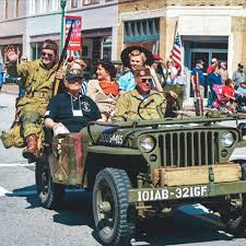 Old time war Jeep full people dressed in world war 2 attire