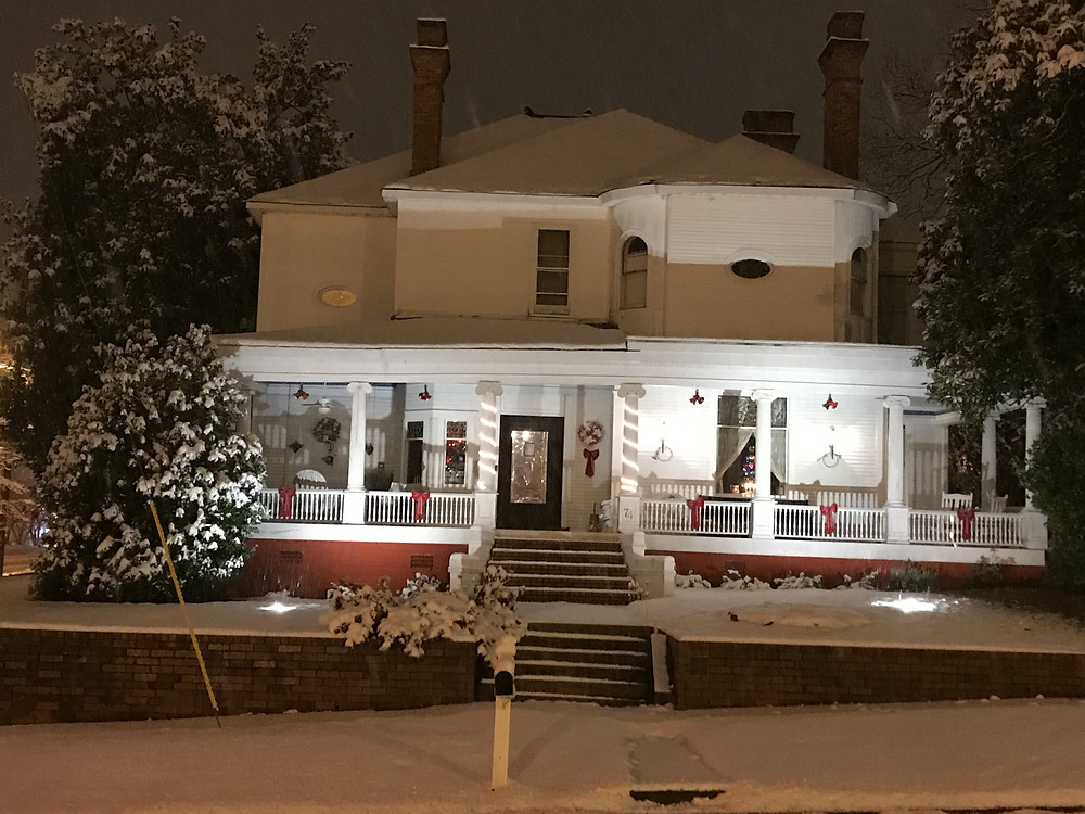 Front of Simmons-Bond house with snow and christmas decorations