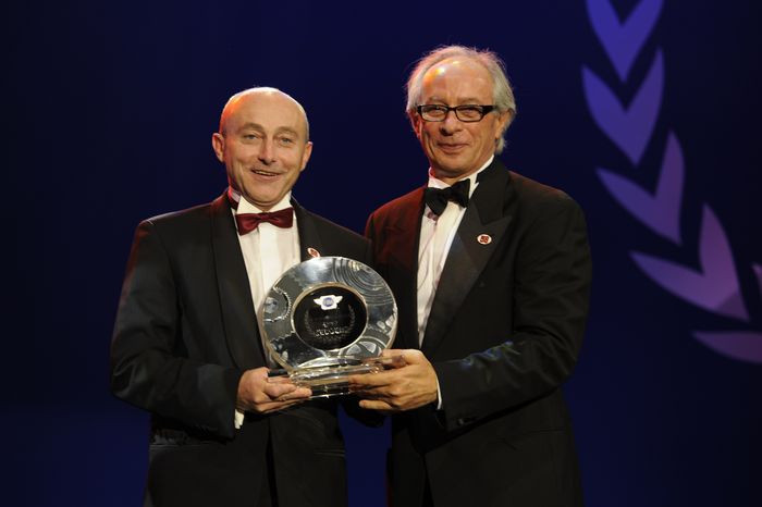 FIM President Vito Ippolito presents the FIM Motocross Legend Trophy to Eric Geboers at the FIM Gala 2011