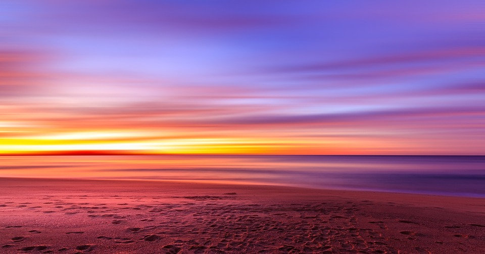 Shore-Purple-Sunset-Sand-Sky-Footprints-