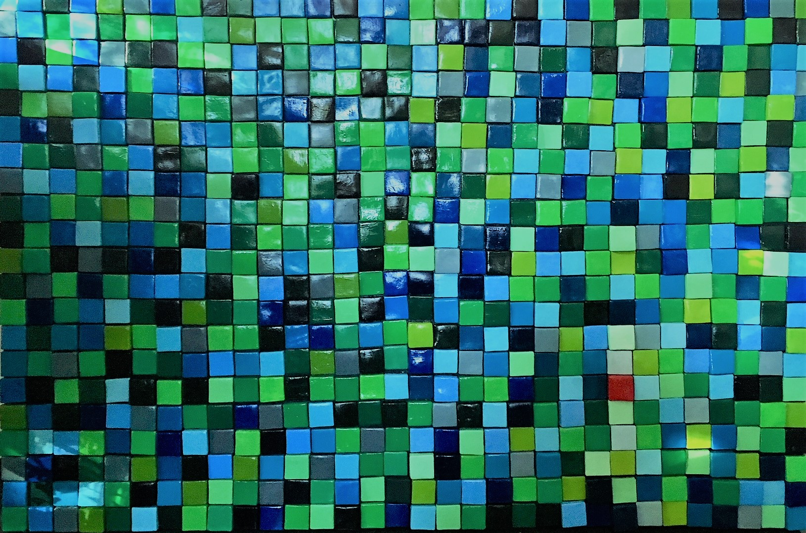 schilderij met 630 groen-blauwe blokjes.
