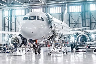 Passenger aircraft on maintenance of engine and fuselage repair in airport hangar.jpg