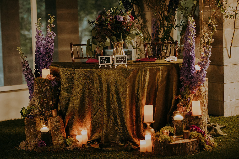 Enchanted Forest themed wedding sweetheart table.