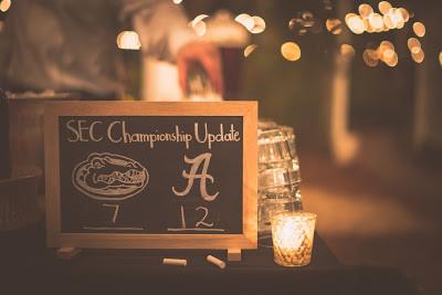 Wedding chalkboard scoreboard for the SEC Championship game between Florida Gators and Alabama Tide.