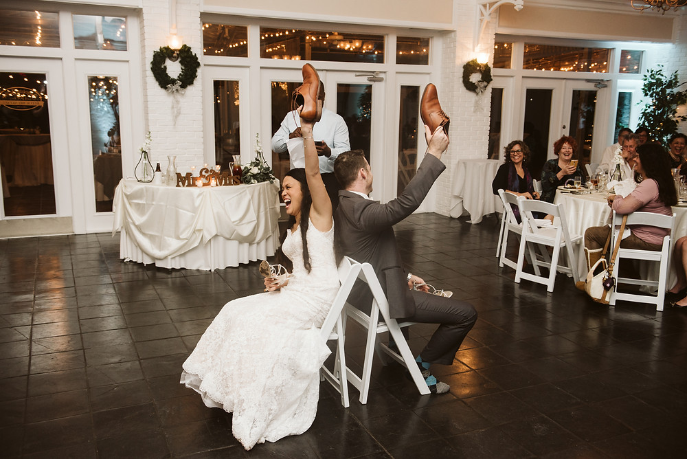 Bride and Groom playing the Shoe Game during their reception at Sweetwater Branch Inn.