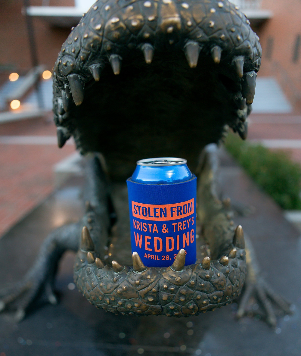 Gator Statue with wedding koozie favor in jaws outside Ben Hill Griffin Stadium