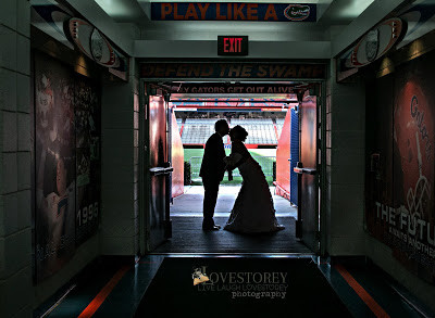 Bride and Groom kissing in the Florida Gator run out tunnel under The Swamp in Ben Hill Griffin Stadium.