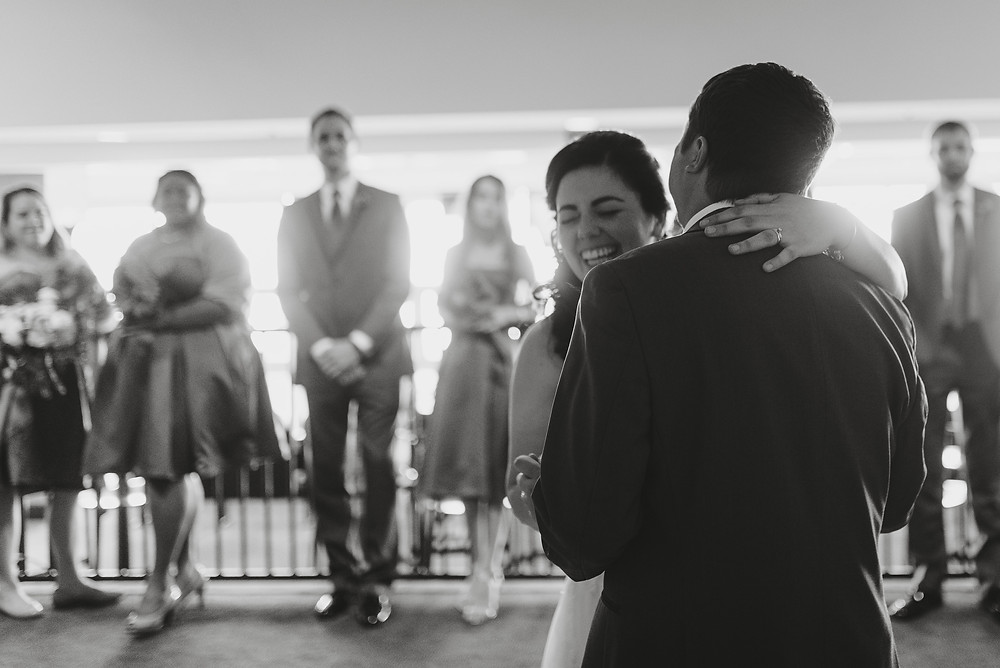 Bride and Groom having their first dance and laughing.
