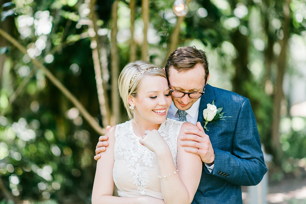 Bride and groom smiling together.