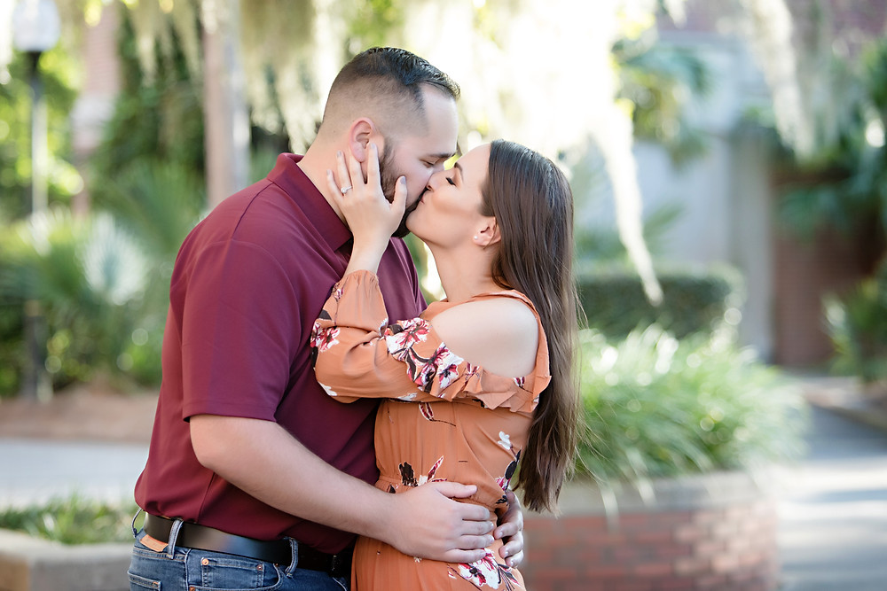 Bride and Groom kissing in engagement photos.
