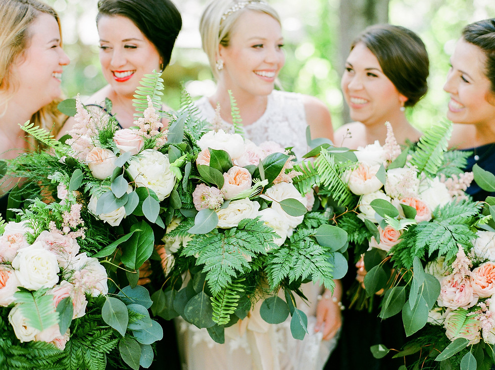 Bride with bridesmaids and their bouquets