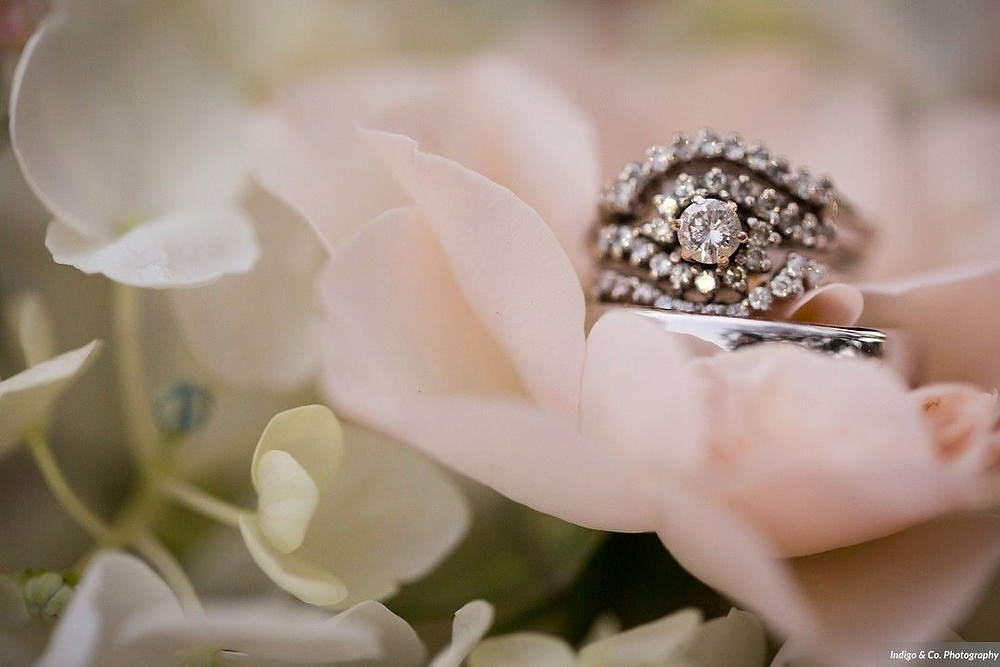 Wedding rings nestled in a pink rose
