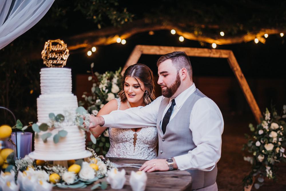 Bride and groom cut their wedding cake at West Light Farm