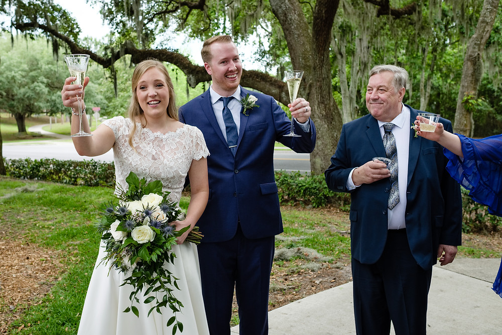 Bride and groom toasting with champagne flutes at the Baughman Center.
