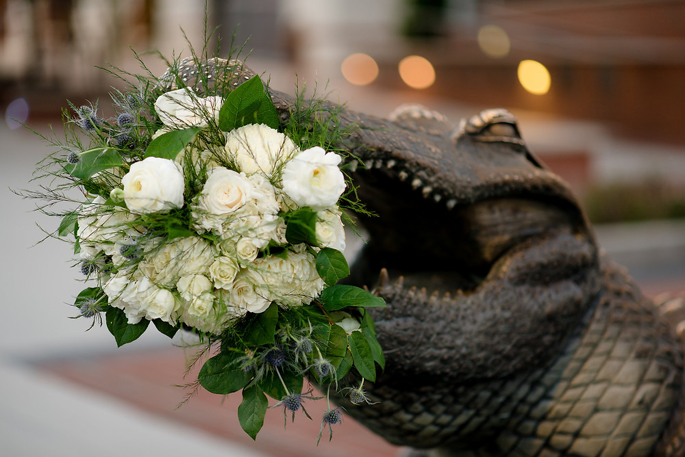 Gator statue with bridal bouquet in its mouth outside Ben Hill Griffin Stadium in Gainesville, Florida.
