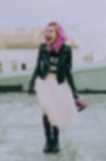 woman-wearing-black-jacket-holding-pink-