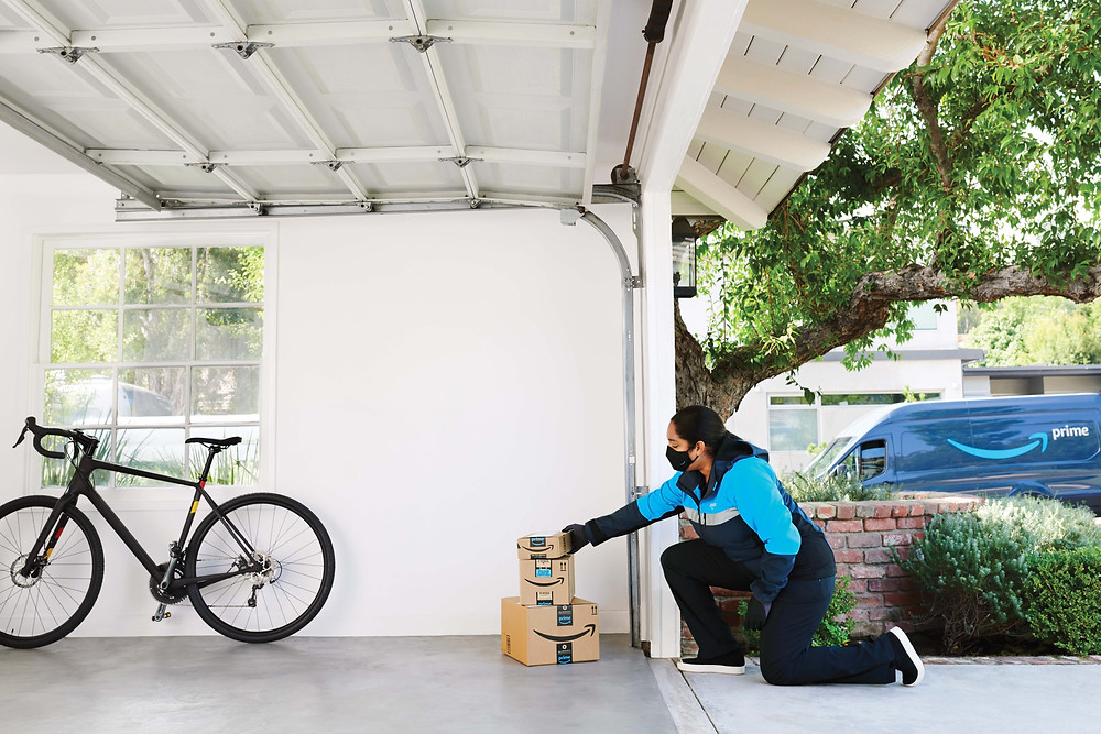 A woman delivers boxes inside customers garage