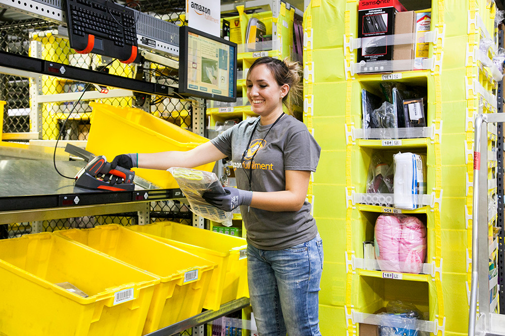 Woman working at an Amazon fulfillment center