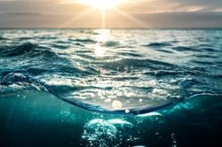 Cloudy Beautiful sunset in sea water. De