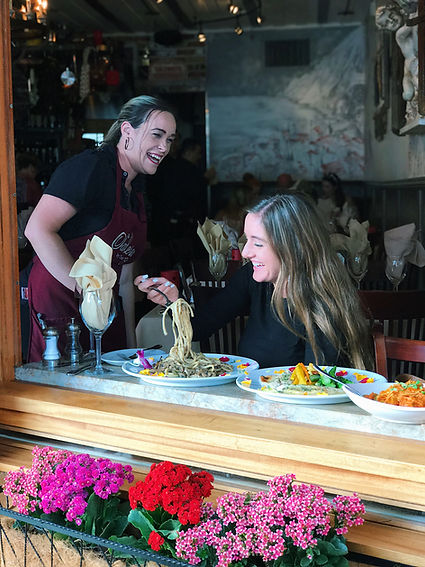 Customers have a great time laughing while eating pasta with our friendly staff at Salerno in Laguna Beach.