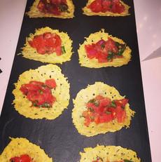Salad of tomatoes, basil on Parmesan tiles