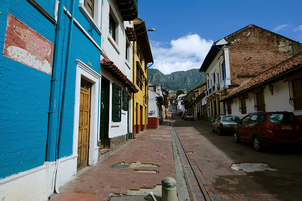 This is the street where my hotel was located. It is in the historic Candelaria district of Bogata, Colombia. It rains a lot in Bogata so this day was exceptionally clear  and you can see all the way down the street to the mountains.