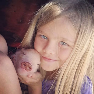 Paisley and her favorite pig from polly