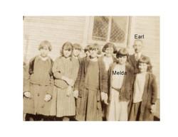 Melda and Earl in school label
