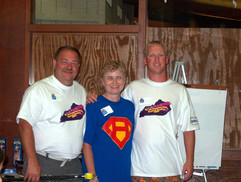 Roger, Nina & Sam indiv golf winners.jpg